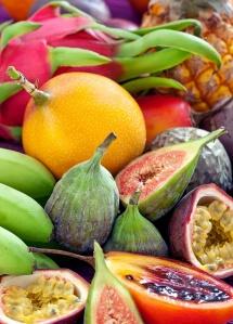 Fruit background .Mix of many fresh tropical fruits .